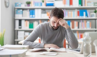 Man studying at the library